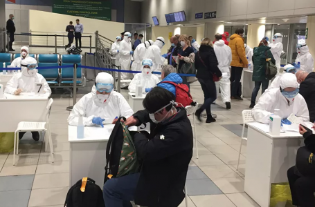 Russian officials and medical staff wearing protective gear check passengers as a preventive measure against the coronavirus (COVID-19) at Moscow's Domodedovo Airport. (Photo: Reuters/Stringer)